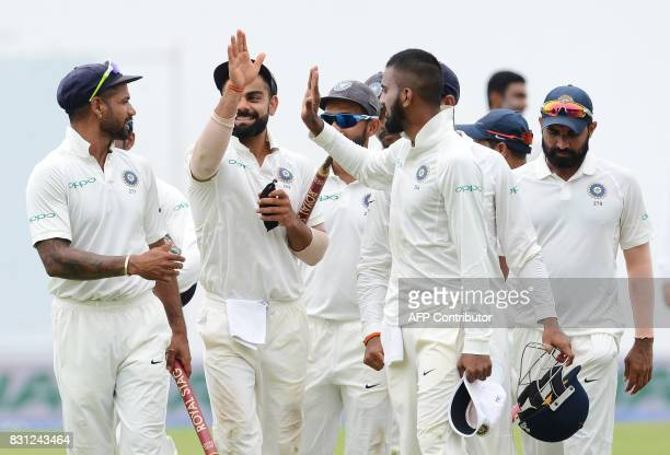 Indian cricket captain Virat Kohli celebrates with his teammates after their victory in the third and final Test match between Sri Lanka and India at...