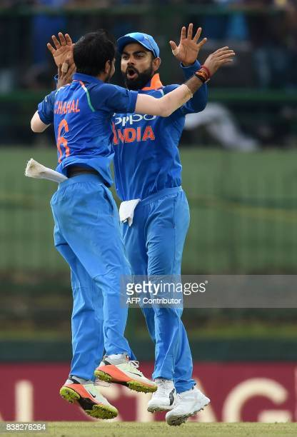 Indian cricket captain Virat Kohli celebrates with Yuzvendra Chahal after he dismissed Sri Lankan cricketer Danushka Gunathilaka during the second...