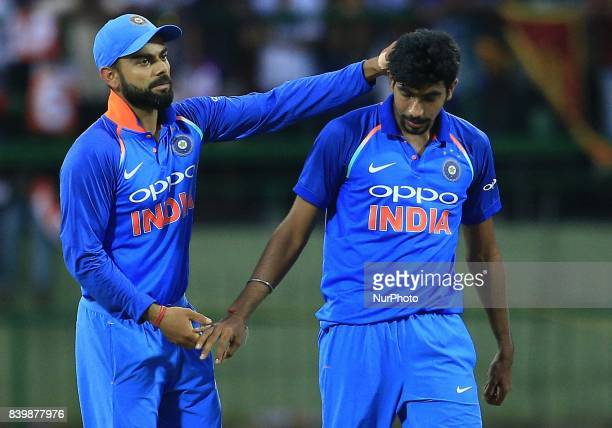 Indian cricket captain Virat Kohli congratulates Jasprit Bumrah during the 3rd One Day International cricket match between Sri Lanka and India at the...