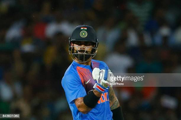 Indian cricket captain Virat Kohli gestures after playing a shot for a boundary during the 1st and only T20 cricket match between Sri Lanka and India...