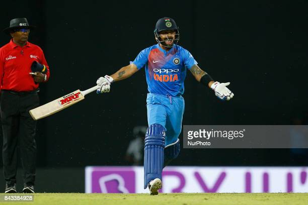 Indian cricket captain Virat Kohli gestures as he runs between the wickets during the 1st and only T20 cricket match between Sri Lanka and India at R...