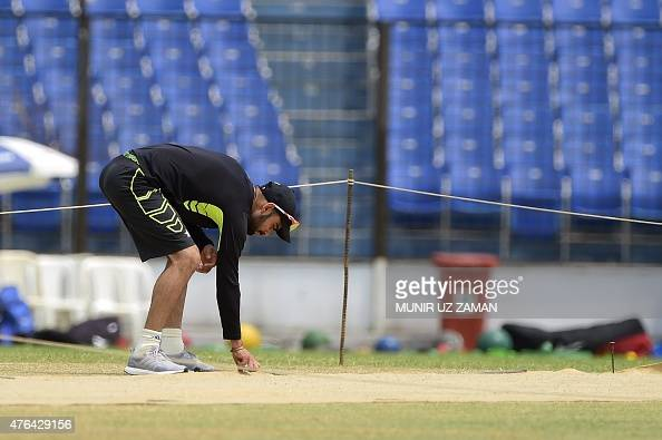 Indian cricket captain Virat Kohli inspects the pitch during a practice session at Khan Shaheb Osman Ali Stadium in Narayanganj on June 9 ahead of...