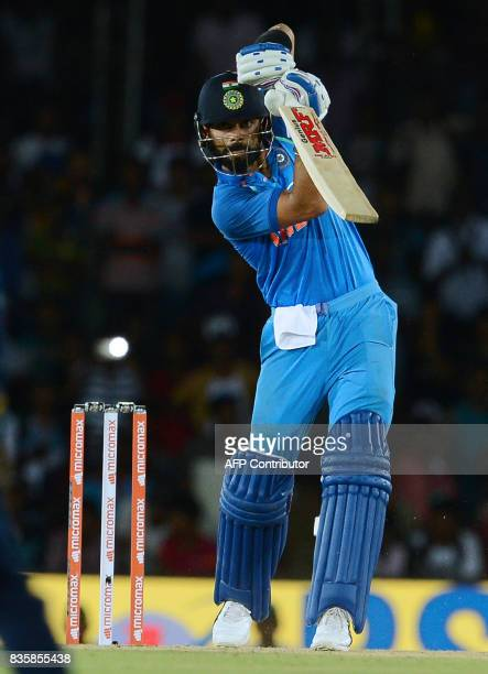 Indian cricket captain Virat Kohli plays a shot during the first One Day International cricket match between Sri Lanka and India at the Rangiri...