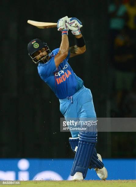 Indian cricket captain Virat Kohli plays a shot during the Twenty20 international cricket match between Sri Lanka and India at R Premadasa Stadium in...
