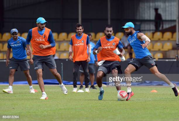 Indian cricket captain Virat Kohli plays football with teammates during a practice session at the Rangiri Dambulla International Cricket Stadium in...