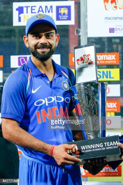 Indian cricket captain Virat Kohli pose with the winners trophy after winning and whitewashing the ODI series against host Sri Lanka by 50 after the...