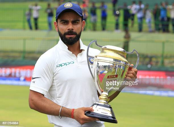 Indian cricket captain Virat Kohli poses with the winners trophy after the 3rd Day's play in the 3rd and final Test match between Sri Lanka and India...