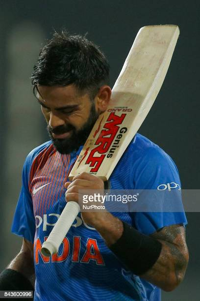Indian cricket captain Virat Kohli raises his bat in acknowledgement after his dismissal during the 1st and only T20 cricket match between Sri Lanka...