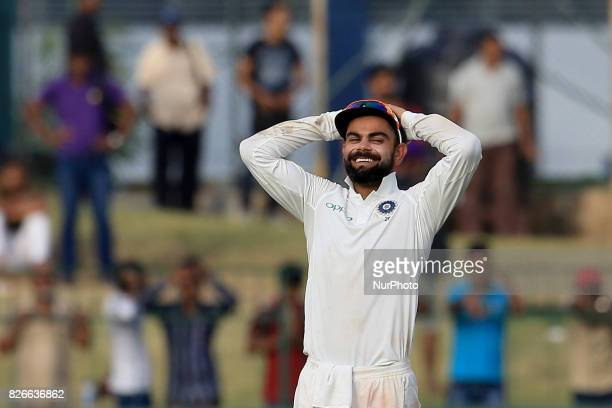 Indian cricket captain Virat Kohli reacts after an unsuccessful appeal during the 3rd Day's play in the 2nd Test match between Sri Lanka and India at...