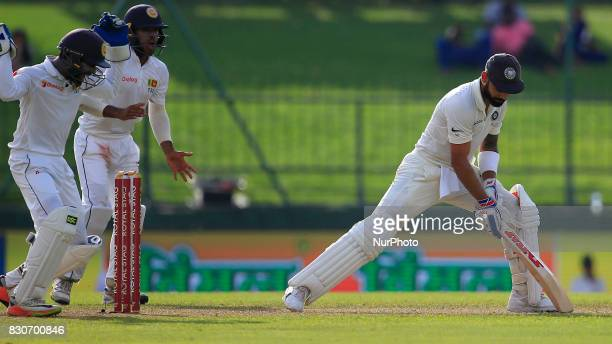 Indian cricket captain Virat Kohli reacts after his dismissal during the 1st Day's play in the 3rd Test match between Sri Lanka and India at the...