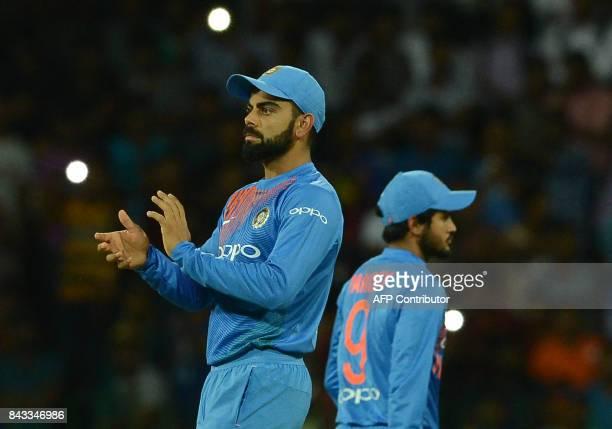 Indian cricket captain Virat Kohli reacts during the Twenty20 international cricket match between Sri Lanka and India at R Premadasa Stadium in...