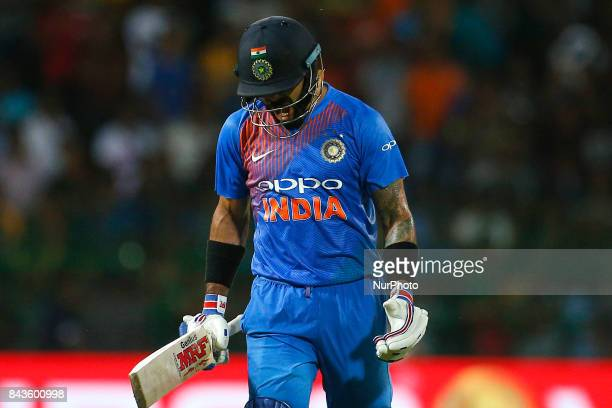 Indian cricket captain Virat Kohli reacts in disappointment after his dismissal during the 1st and only T20 cricket match between Sri Lanka and India...