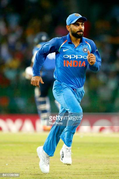 Indian cricket captain Virat Kohli runs after the ball during the 4th One Day International cricket match between Sri Lanka and India at the R...