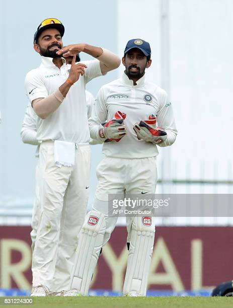 Indian cricket captain Virat Kohli signals for third umpire review for unsuccesful wicket of Sri Lankan cricketer Angelo Mathews during the third day...