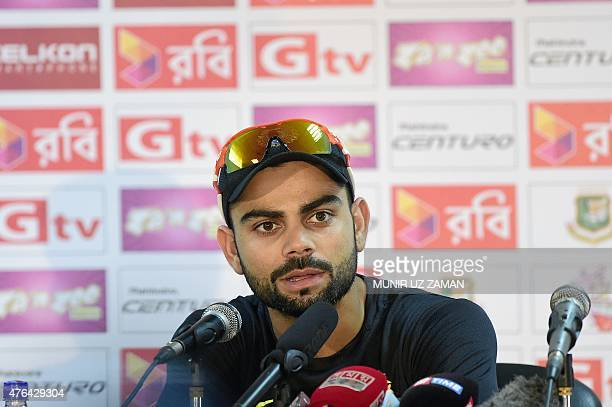 Indian cricket captain Virat Kohli speaks with the press prior to a practice session at Khan Shaheb Osman Ali Stadium in Narayanganj on June 9 ahead...