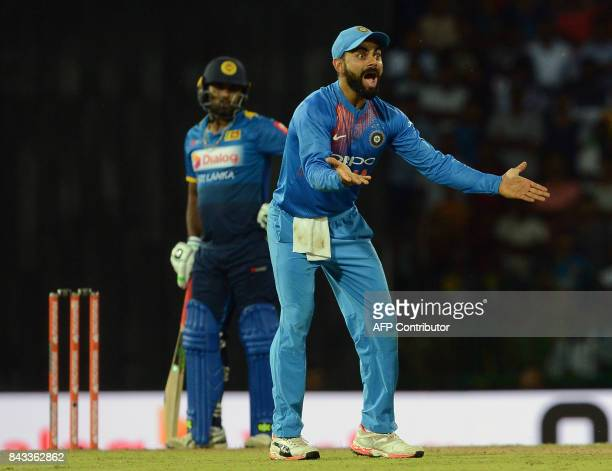 Indian cricket captain Virat Kohli unsuccessfully appeals against Sri Lankan cricketer Seekkuge Prasanna during the Twenty20 international cricket...