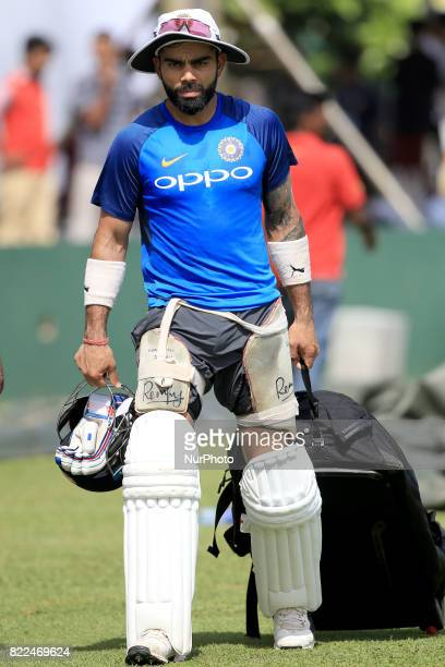 Indian cricket captain Virat Kohli walks away after taking part in a practice session ahead of the 1st test match between Sri Lanka and India at...