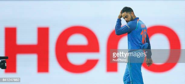 Indian cricket captain Virat Kohli walks back to the pavilion after beating Sri Lanka by 168 runs during the 4th One Day International cricket match...