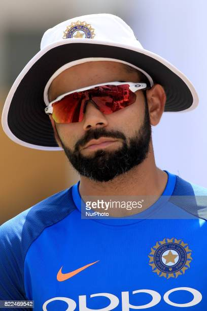 Indian cricket captain Virat Kohli walks in the ground after a press conference to take part in a practice session ahead of the 1st test match...