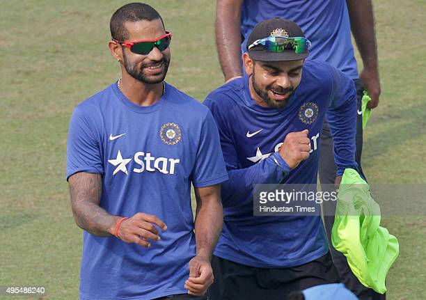 Indian cricket captain Virat Kohli with teammate Shikhar Dhawan during practice session before the scheduled test match series against South Africa...