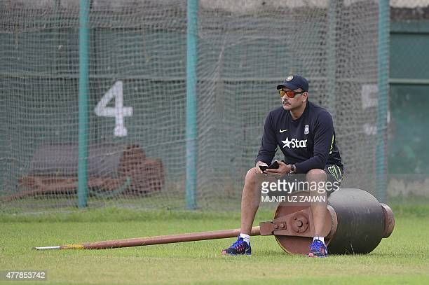Indian cricket coach Ravi Shastri looks on during a practice session at The ShereBangla National Cricket Stadium in Dhaka on June 20 2015 AFP PHOTO/...