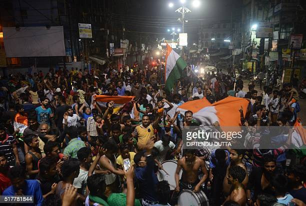 Indian cricket fans celebrate in streets of Siliguri on March 27 after India beat Australia in a World T20 cricket tournament match India reaches in...