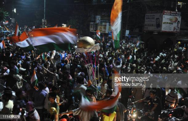 Indian cricket fans celebrate victory over Sri Lanka in Siliguri on April 2 after the ICC Cricket World Cup 2011 final match between India and Sri...