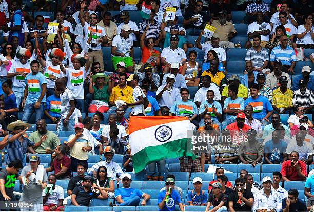 Indian cricket fans cheer during the second match of the TriNation series between Indian and West Indies at the Sabina Park stadium in Kingston on...