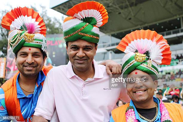 Indian cricket fans pose during the One day International Cricket Match between India and South Africa at SAHARA Stadium Kingsmead in Durban on...
