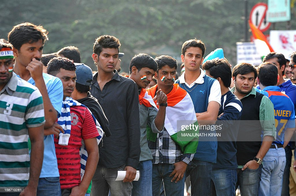 Indian cricket fans wait in line outside The M. Chinnaswamy Stadium in Bangalore on December 25, 2012. Police were out in full force in the southern Indian city as part of a massive security operation ahead of Pakistan's first cricket tour of India for five years. AFP PHOTO/Manjunath KIRAN