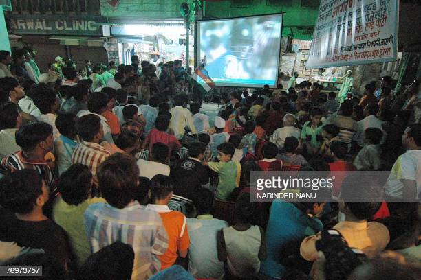 Indian cricket fans watch the final match of the ICC Twenty20 World Cup between Pakistan and India held at the Wanderers Cricket Stadium in...