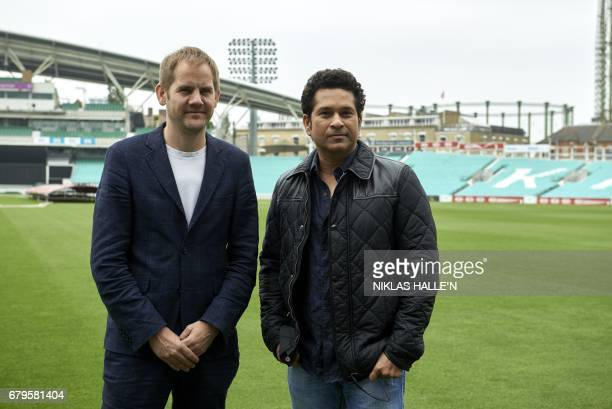 Indian cricket legend Sachin Teldulkar and British movie director James Erskine pose for a photograph during a photocall at the Oval cricket ground...
