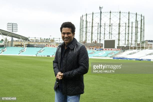 Indian cricket legend Sachin Teldulkar poses for a photograph during a photocall at the Oval cricket ground in south London on May 6 promoting the...