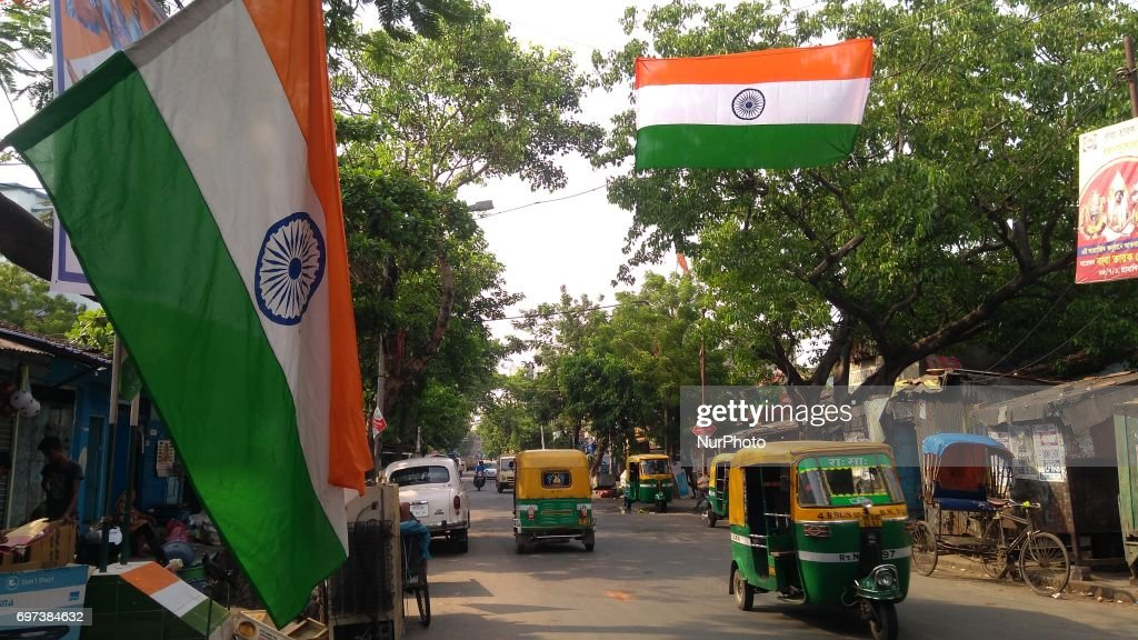 Indian cricket lover hanging Indian national flag road side during India v Pakistan final ICC champion trophy Cricket Matches on June 18,2017 in Kolkata,India.
