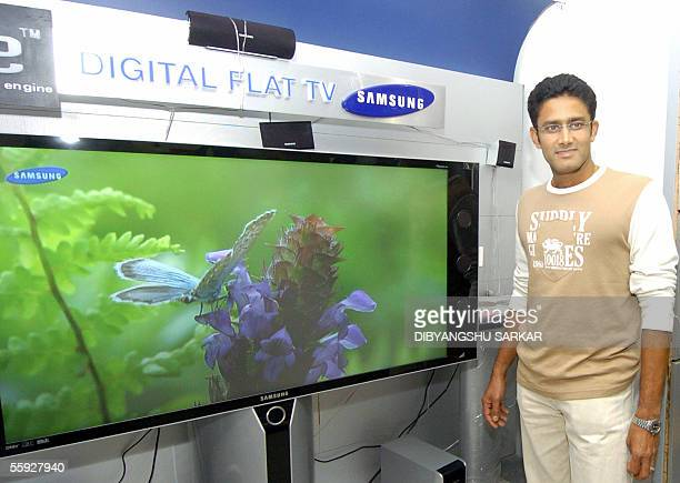 Indian cricket player Anil Kumble stands next to a Samsung projection television at a Samsung showroom in Bangalore 15 October 2005 Anil Kumble the...
