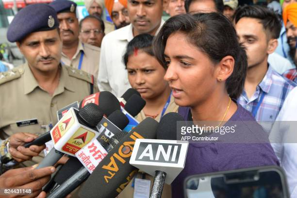 Indian cricket player Harmanpreet Kaur speaks with the media upon arriving at Shri Guru Ram Das Ji International Airport in Amritsar on July 30 2017...
