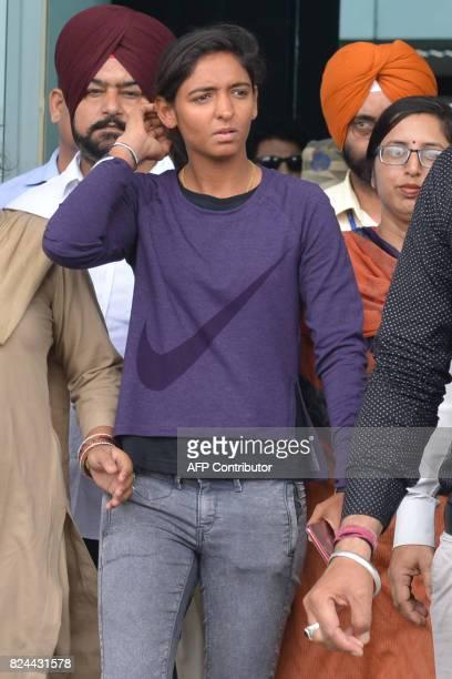 Indian cricket player Harmanpreet Kaur walks after arriving at Shri Guru Ram Das Ji International Airport in Amritsar on July 30 2017 / AFP PHOTO /...