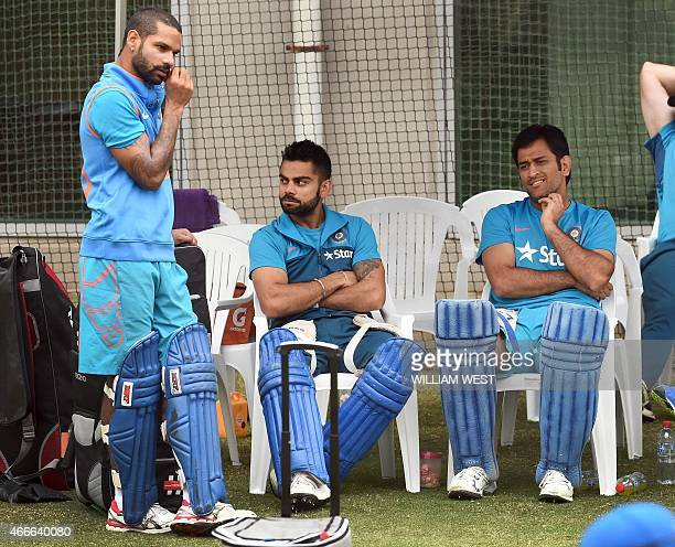 Indian cricket players Shikhar Dhawan Virat Kohli and captain Mahendra Singh Dhoni share a lighter moment during a training session ahead of their...