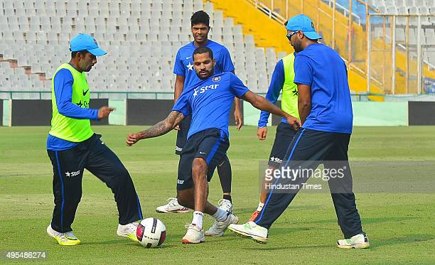Indian cricket players Wriddhiman Saha Shikhar Dhawan Umesh Yadav and Murali Vijay during practice session before the scheduled test match series...