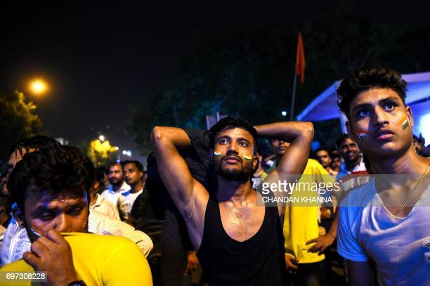 Indian cricket supporters react as Pakistan won the ICC Champions Trophy final cricket match against India in New Delhi on June 18 2017 Pakistan...