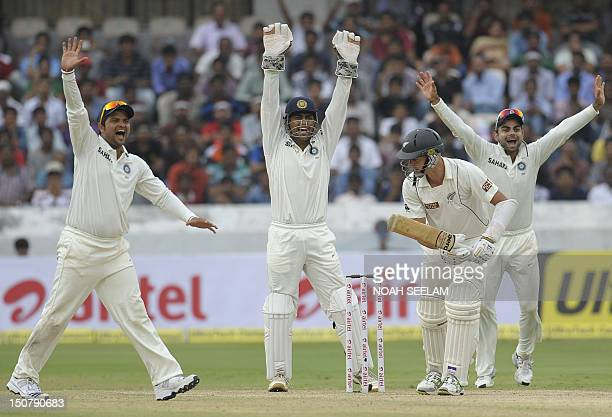 Indian cricket team captain and wicketkeeper Mahendra Singh Dhoni with teammates Suresh Raina and Virat Kohli sucessfully appeal for a leg before...