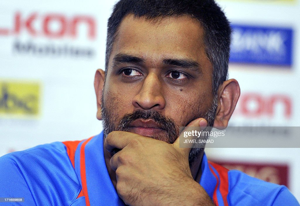 Indian cricket team captain Mahendra Sing Dhoni listens to a question during a unveiling ceremony of Celkon Tri-Nation series cup in Kingston on June 27, 2013. Sri Lanka will face West Indies in the first match of a Tri Nation series involving India too. AFP PHOTO/Jewel Samad