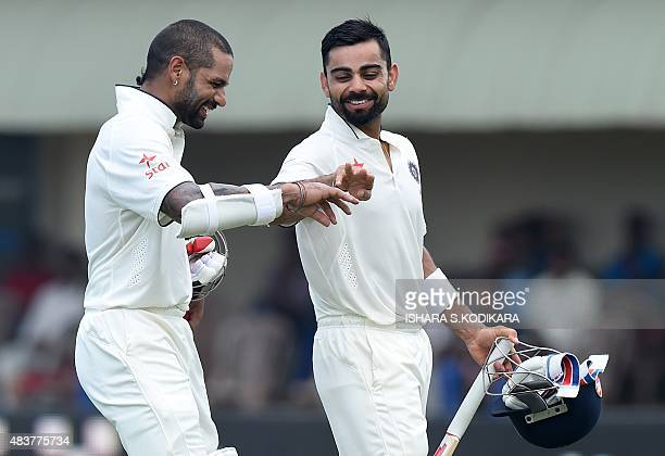 Indian cricket team captain Virat Kohli and Shikhar Dhawan leave the field for lunch during the second day of the opening Test match between Sri...