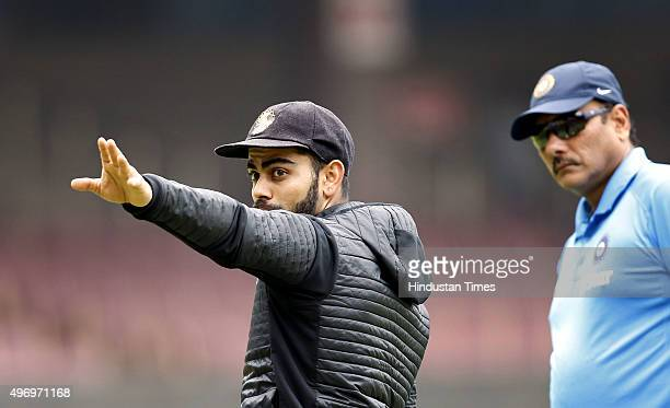 Indian Cricket team Captain Virat Kohli and team director Ravi Shastri during a practice session at M Chinnaswamy Stadium on November 13 2015 in...