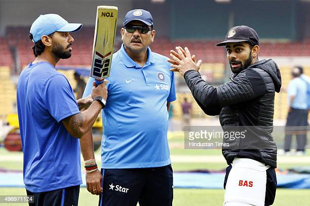 Indian Cricket team Captain Virat Kohli and team director Ravi Shastri giving the tips to Murali Vijay during a practice session at M Chinnaswamy...
