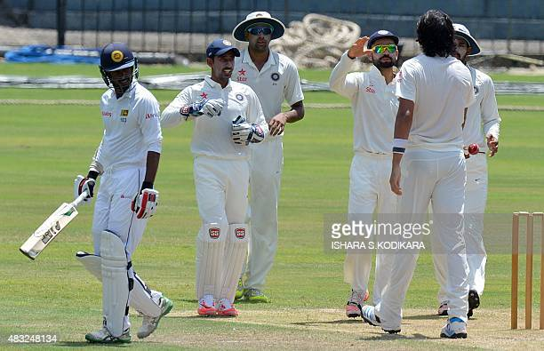 Indian cricket team captain Virat Kohli and teammates celebrate after dismissing Sri Lanka Board President's XI cricketer Upul Tharanga during the...