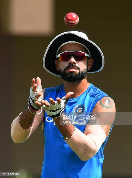 Indian cricket team captain Virat Kohli catches the ball during a practice session at Galle International Cricket Stadium in Galle on July 24 2017...
