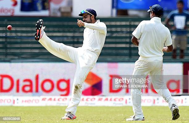 Indian cricket team captain Virat Kohli celebrates after he dismissed Sri Lankan cricketer Kusal Perera during the third day of their third and final...