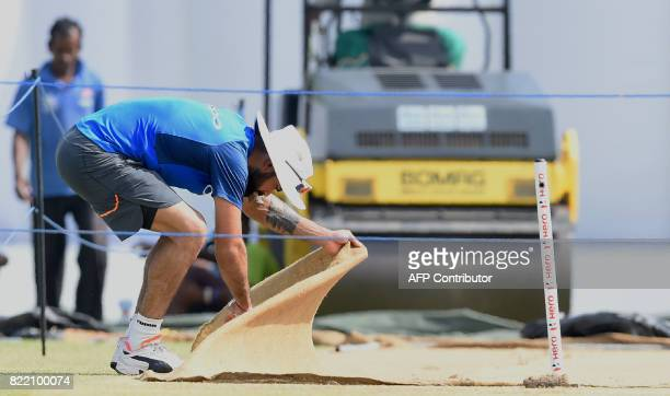 Indian cricket team captain Virat Kohli inspects the pitch during a practice session at Galle International Cricket Stadium in Galle on July 25 2017...