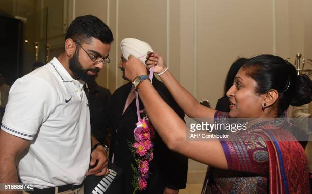 Indian cricket team captain Virat Kohli is given a traditional welcome as he arrives with teammates at a hotel in Colombo on July 19 2017 India and...